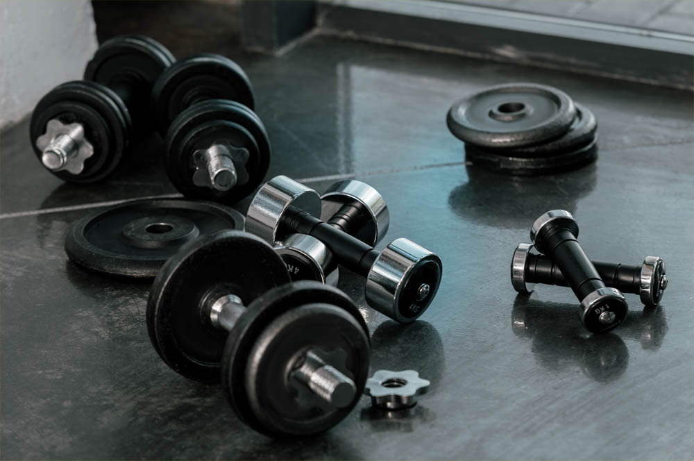 A group of dumbbells left on the floor